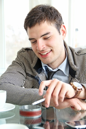 Closeup of a happy young business man with copy-space photo