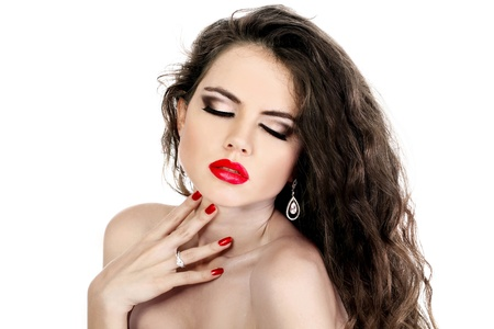Glamour portrait of beautiful woman model with red lips and red manicure isolated on white background photo
