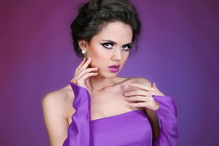 Attractive portrait of beautiful woman model with fashion makeup and romantic wavy hairstyle. Stock Photo - 11866566
