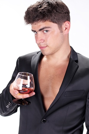 Man with glass of cognac on white background Stock Photo - 11933850