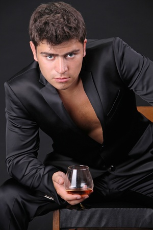 Closeup of senior man sitting at the table having a glass of cognac Stock Photo - 11933846