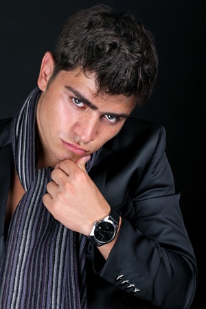 Elegant young handsome man,  intense gaze photo