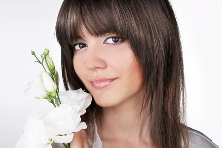 Portrait of a beautiful female model on white background photo