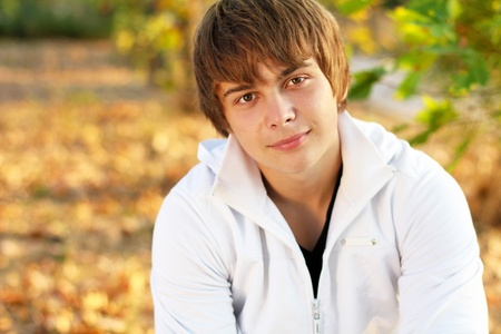 Portrait of attractive young man outdoors, looking at camera photo