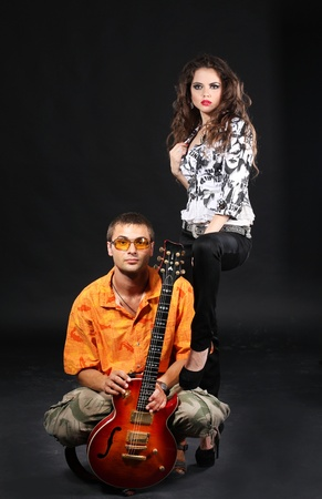 Young woman and man with guitar, man under petticoat government photo