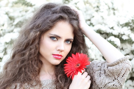 Natural beauty Young woman with red flower, outdoors portrait photo