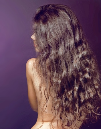 Healthy long curly brown-haired person of Beautiful Girl photo