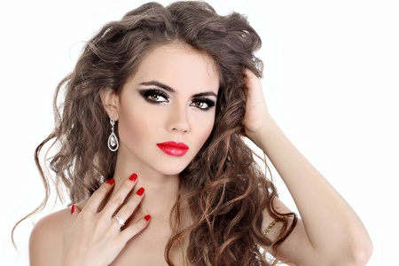 Young beautiful woman with red lips and long curly hairs - isolated on white
