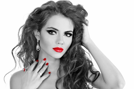 Fashion Brunette   Beautiful Makeup and Healthy Black long curly hairs - black and white photo Stock Photo