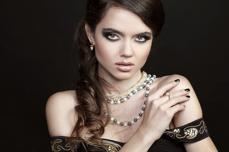 Beautiful woman with evening make-up  Fashion jewelry decoration photo