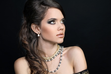 Fashion Beautiful woman with evening make-up  Jewelry and Beauty photo photo
