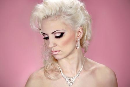 Beautiful woman with evening make-up  Jewelry and Beauty  Fashion  photo