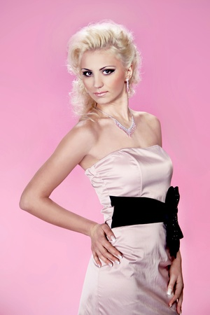 Beautiful young lady wearing pink elegant dress over pink Stock Photo - 13051027