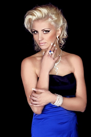 Beautiful Blond Girl with evening make-up,Jewelry Fashion and beauty photo
