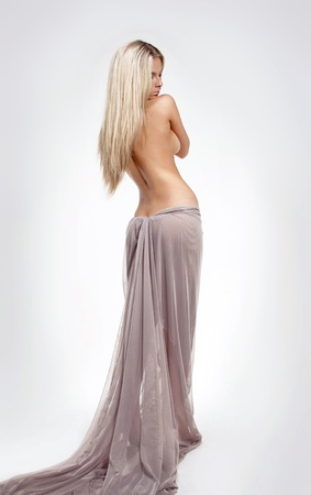 Fashion blond beautiful female model with Straight Long Hair, body care Stock Photo - 13122404