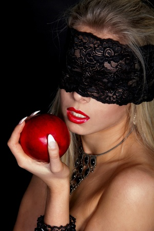 Beautiful Woman with Black lace eating Red apple isolated on black photo