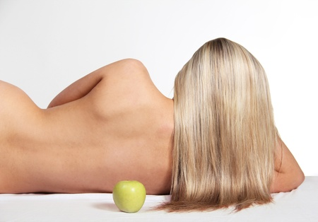 Beautiful Woman with Straight Long Hair and Green Apple Stock Photo - 13122415
