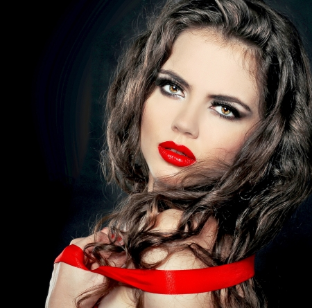 Fashion Woman with red lips isolated on black background photo