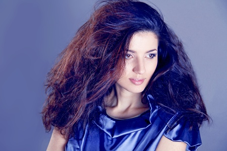 Fashion Brunette over blue   Beautiful Makeup and Healthy Black Hair photo