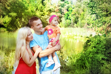 Happy family having fun outdoors, looking in happy future photo