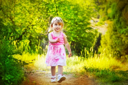 coutryside: Happy funny little girl walking on road, nature outdoors Stock Photo