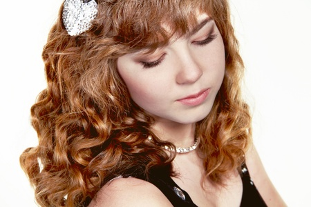 Girl with red curly health hair style, studio salon photo