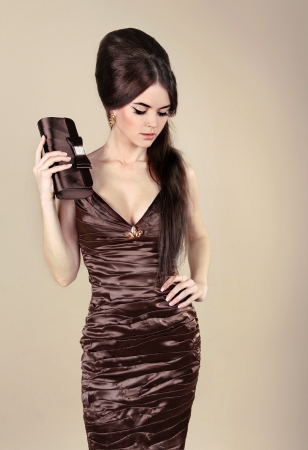 Elegant Fashion Sexy Woman in chocolate dress with small bag Stock Photo - 13842124