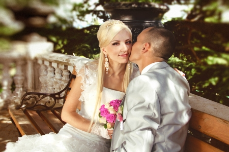 Groom kissing bride on their wedding day  photo