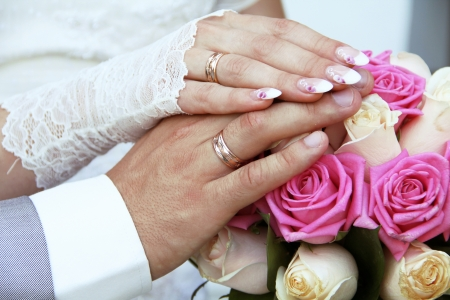 Wedding rings on fingers, hands photo