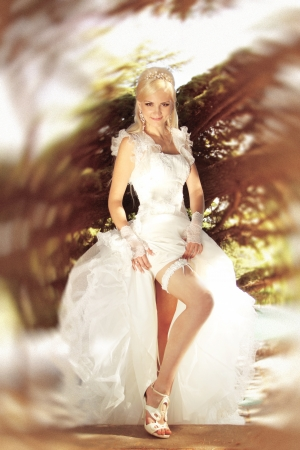 sexy bride: Elegant bride showing sexy leg with her garter