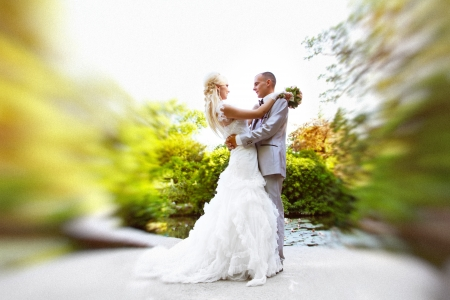 Wedding dance the bride and groom on a green nature background photo