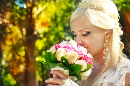 Bride with bouquet in the hands, portrait