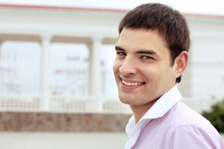 Closeup Portrait of happy smiling man over architecture building outdoors  photo