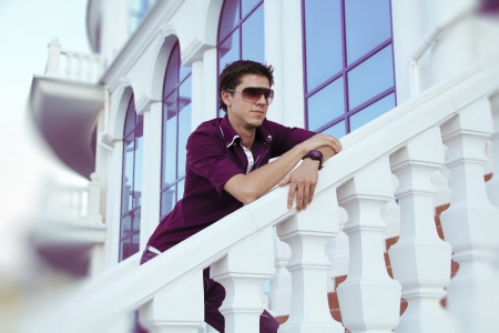 Attractive young man wearing sunglasses photo