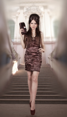 Fashion woman in gorgeous dress photo