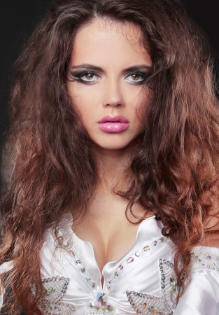 portrait of Beautiful Woman with Long Curly Hair photo