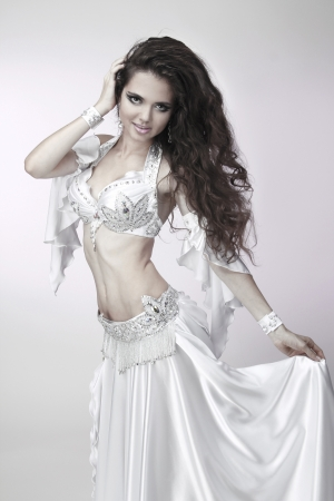 Belly dancer in a white costume photo