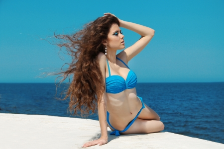 Beautiful young woman with Long Curly Hair on blue sky Stock Photo - 14886798