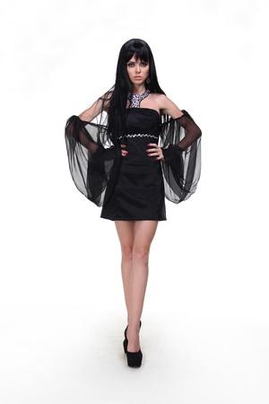Fashion woman model wearing black dress with wing, long legs Stock Photo - 15190170