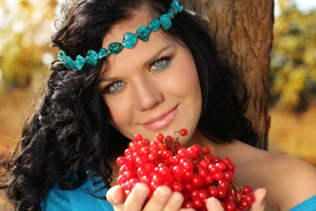 guelder: Portrait of beautiful Woman on rest with berry in her hands