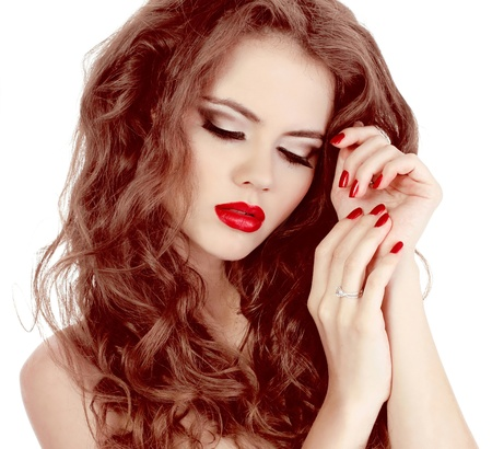Portrait of sexy beautiful woman with red manicure nails, make-up and curl hairs Stock Photo