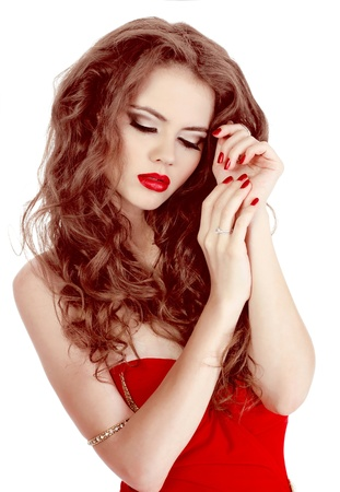 Portrait of sexy beautiful woman in red dress with make-up and curl hairs photo