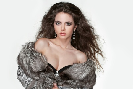 Fashion elegant Girl in Luxury Fur Coat, brunette hair photo