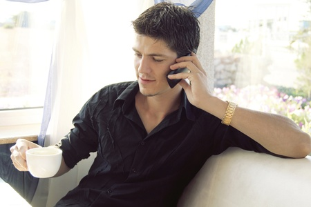 Portrait of successful business man enjoying conversation over the cellphone, Copyspace photo