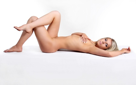 nude breasts: Beautiful nude young woman over white background