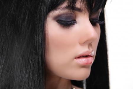 smoky: Eyes Makeup. Brunette Girl . Beautiful Makeup and Healthy Hair