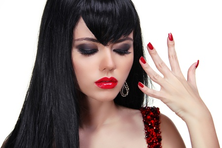 Sensual brunette woman with red lips and nails manicure, silky hair Stock Photo - 15607570