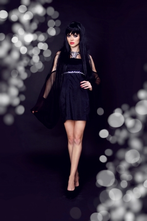 Portrait of a beautiful sexy young woman in black dress Stock Photo - 15607555