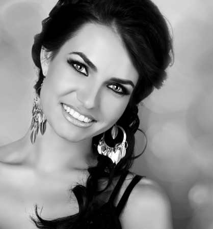 Attractive smiling woman, black and white portrait  photo