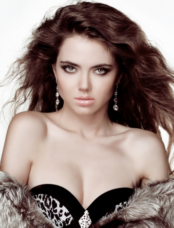 Fashion brunette woman in fur coat with evening make-up. Jewelry and Beauty. Stock Photo - 15610575